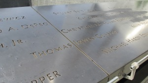 Names of victims/heroes inscribed on the panel of one of the reflecting pools.